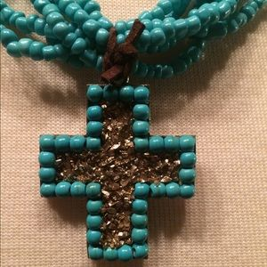 Turquoise color cross necklace